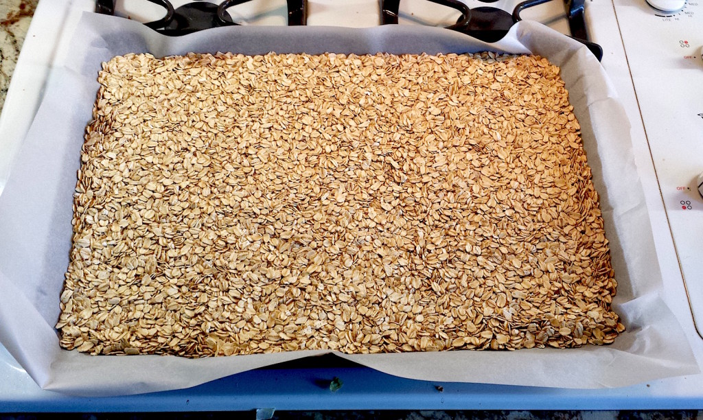 Spread the oats out on a parchment lined baking sheet.