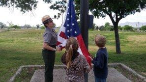 Helping the ranger raise the flag