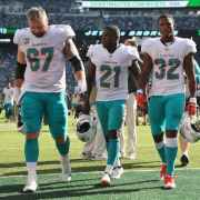 Dolphins trudge off after what may be a season filled with losses. (Tony Capobianco for Five Reasons Sports)