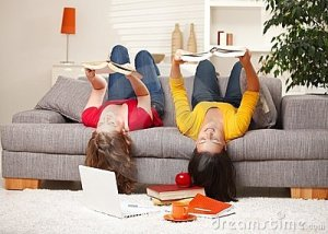 girls-reading-upside-down-sofa