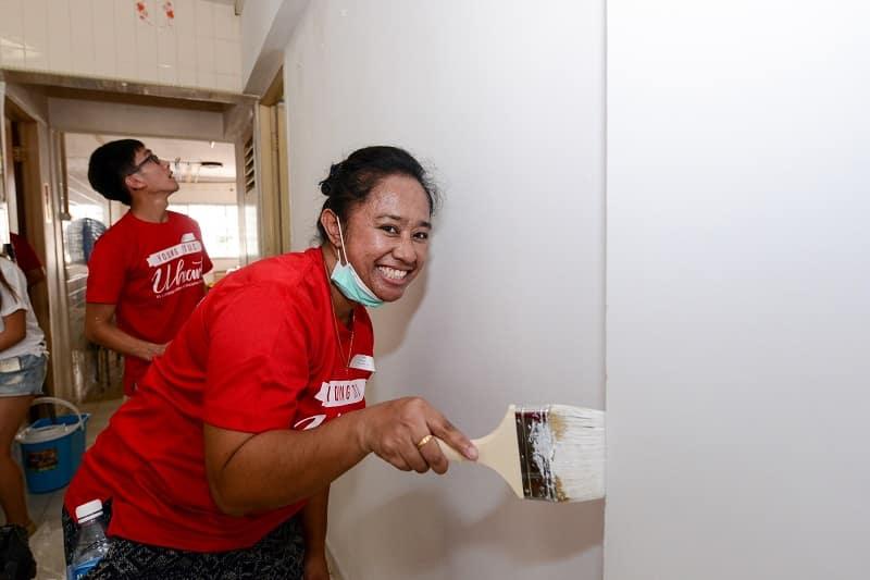 Happily painting - volunteering in singapore