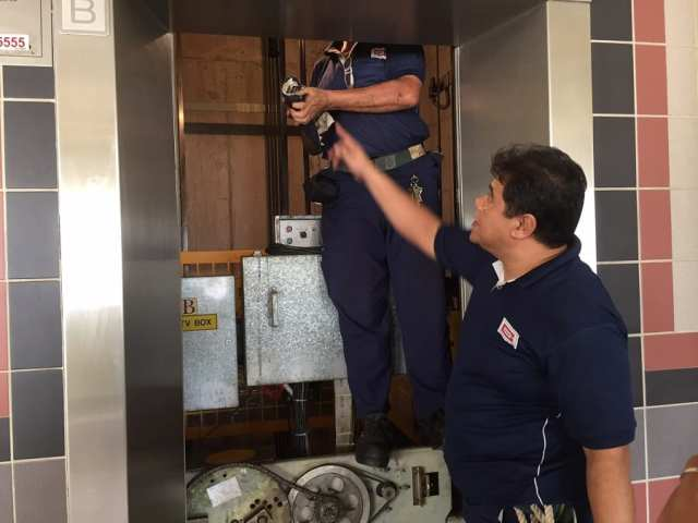 Lift technicians work in pairs