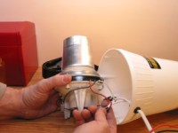 A motor from a small appliance can be reused in many ways, including taking it apart to learn how motors work.