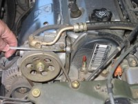 The engine oil level should be between the two marks on the dip stick. See the car's manual for specifics.