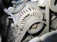 An engine belt turns the alternator which produces electricity for storage in the battery.