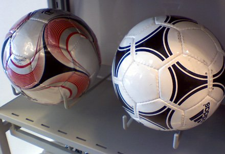 Utility Hooks display soccer balls among sportswear offerings.