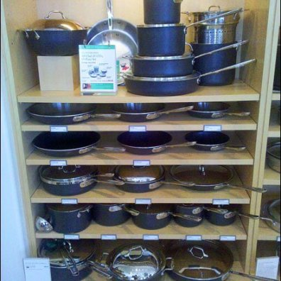 Cookware Merchandised From Wood Shelves