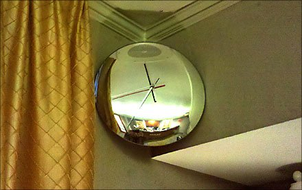 Convex Mirror As Wall Clock and Security Device