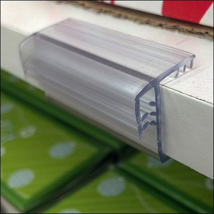 Acrylic Solid Shelf Label And Sign Holder Fixtures Close Up