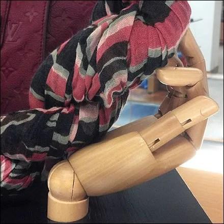 Vuitton Braids a Scarf by Hand Closeup