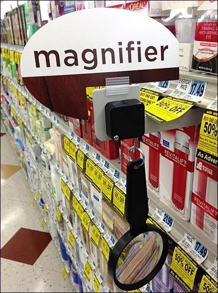 Magnifying Glass Teathered at Shelf Edge