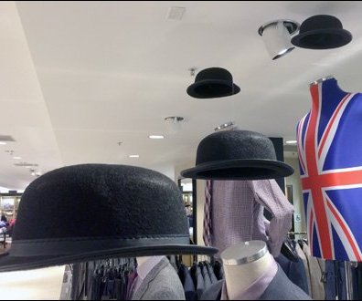 Bowler Hats Off In The Air Closeup