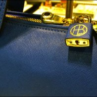 Henri Bendel Branded Lock For Purses