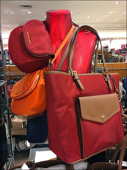 Micahel Kors Red Satin Dressform Purse Display