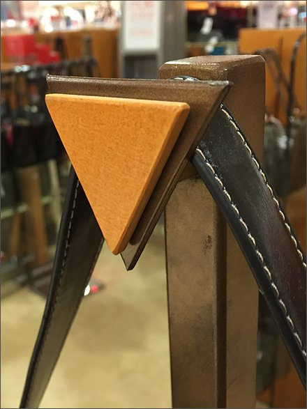 Triangular Finial as Wood-tone Directional
