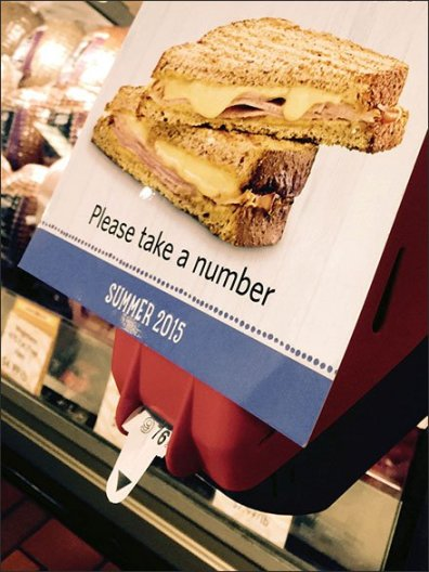 Take-The-Next-Number Queue Advertising