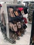 Gravity-Feed Hooks in Shoe Merchandising