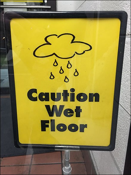 When-It-Rains-It-Pours Wet Floor Warning Shovel-Base Sign