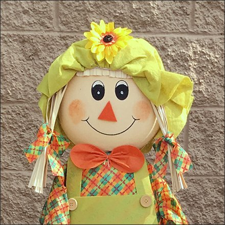 Scarecrow Retail Outfitting - Scarecrow Girl Tends Floral Offering
