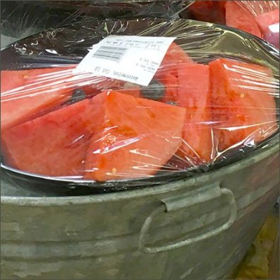 Iced Melon Wash Tub Display At Sickles Market