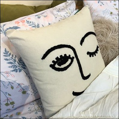 Winking Pillow Prop In Bed at Macys