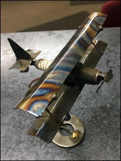 Bi-Plane Spark Plug Visual Merchandising Hero