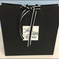 Saks Be-Ribboned and Branded Shopping Bag