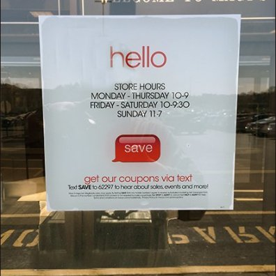 Dueling Hello and Welcome Signs at Macys