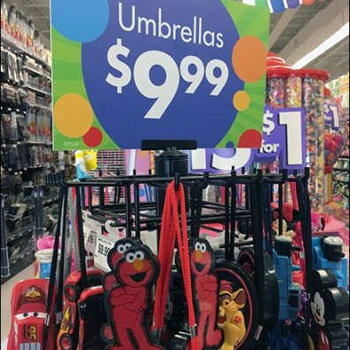 Elmo Umbrella Tree Sign As Merchandising Focus