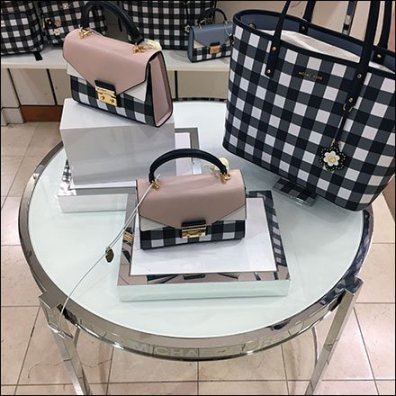 Michael Kors Branded Circular Table Display Feature