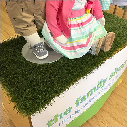 Artificial Turf in Apparel Visual Merchandising Feature