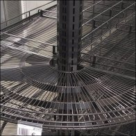 Euro Fixtures: Curved Wire Shelf Endcap Design