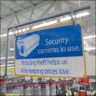 Security Cameras In Use Sign Arm Overhead