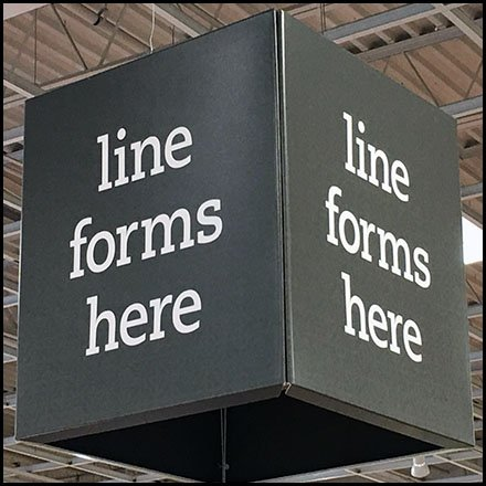 Line Forms Here Overhead Sign
