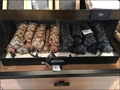 Coach Branded Umbrella Tray Merchandising