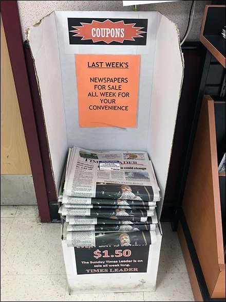 Last Week's Newspapers Corrugated Stand