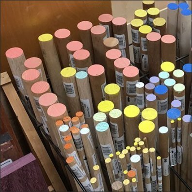 Color-Coded Dowels In a Wire Rack Feature