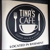 Tina's Cafe Basement Location Sign