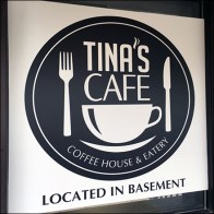 Tina's Cafe Located in Basement Sign Feature