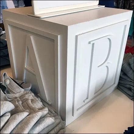Polo Alphabet-Block Visual Merchandising Feature