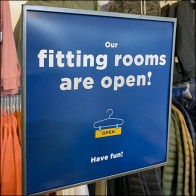 Our Fitting Rooms Are Open Sign