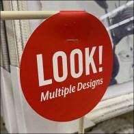 Multiple Poster Designs Look Flag