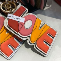Coach Love-Branded Keychain Hitching Post