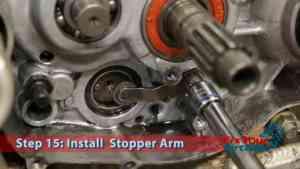 Step 15: Install Stopper Arm