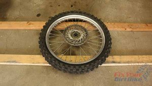 Step 4 - Place Wheel On 2x4s