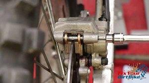 Install - Torque Brake Pad Pin To 13 ft-lbs