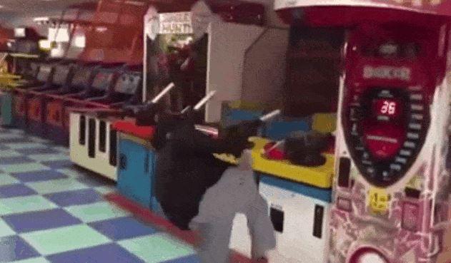 Guy Kills Arcade Machine With Badass Spinning Kick