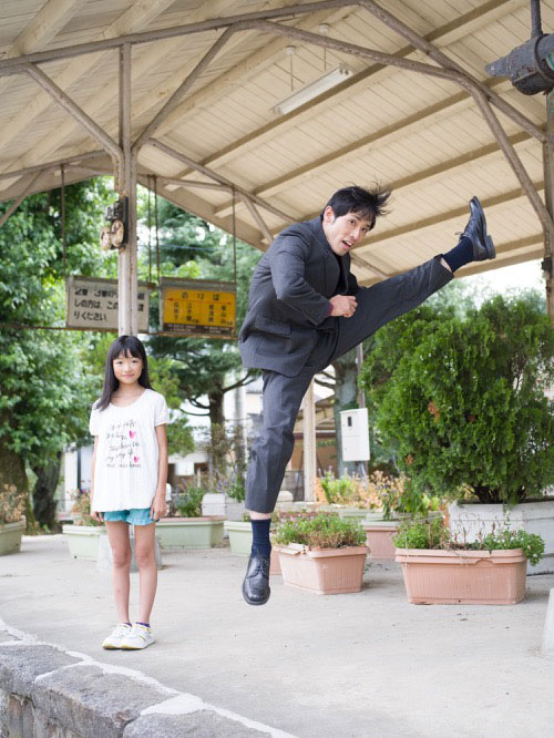 Japanese Businessmen Jumping Beside their Daughters