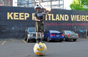 Guy Riding a Giant Ball Playing Star Wars with a Flaming Bagpipe