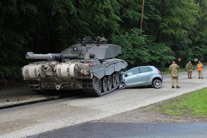 Teen-crashes-with-tank-jpg
